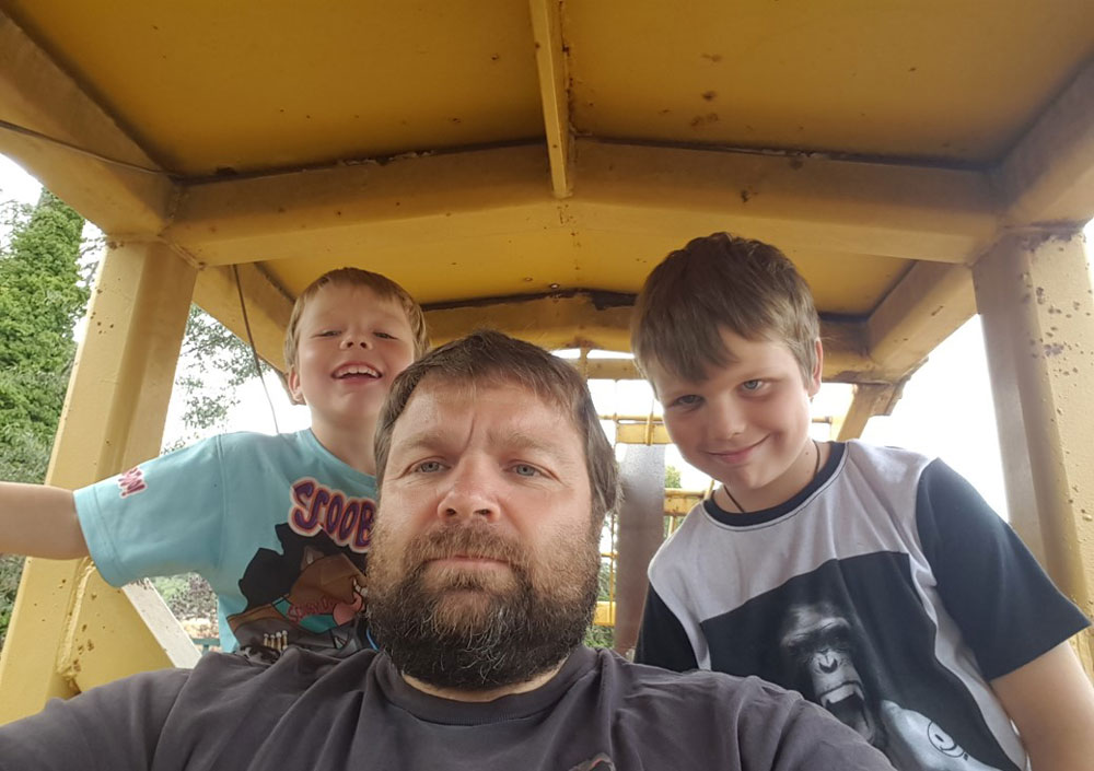 Jason Malatesta & his sons on the loader. Both boys are already quite competent operators.