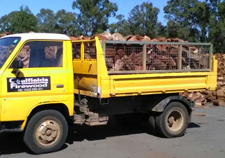 A truckload of dry firewood heading off to one of our happy customers.